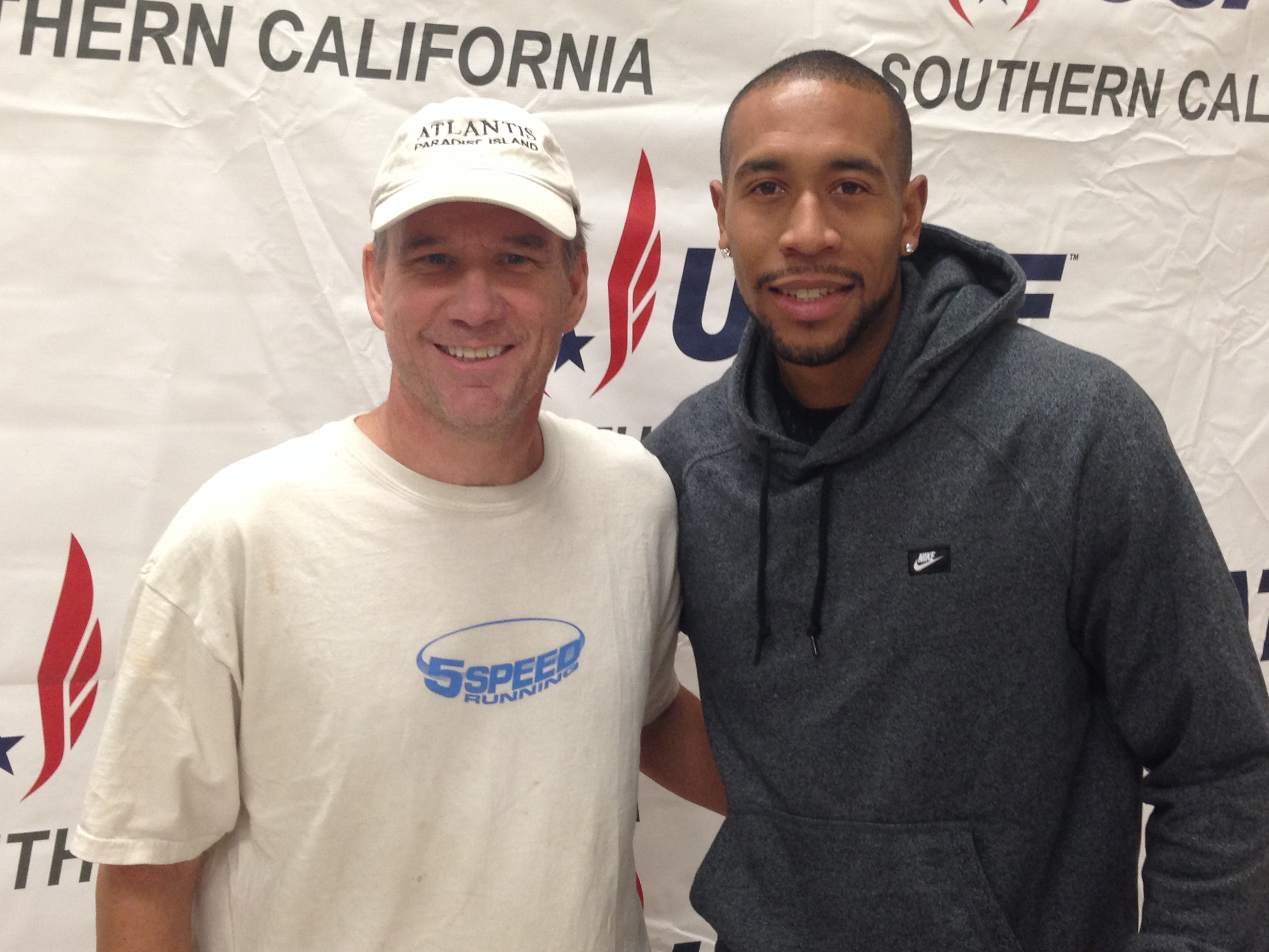 Coach Rickerman is a USATF Certified Coach. (Pictured here with Bryshon Nellum at a USATF elementary school event)